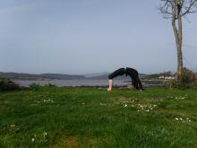 Photo of person in a yoga position in the countyside