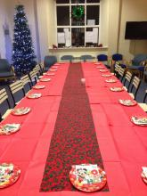 photo of the room decorated for a Christmas lunch